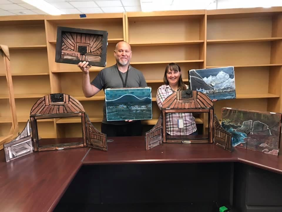 Principal Peggy Azuyak and coworker showing their display of story teller theater boxes.